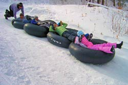 snow tubing is a great winter activity for kids