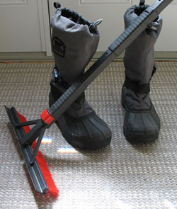 snow boots and a snow scraper
