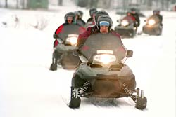 a group of snowmobilers enjoying the day on the trails